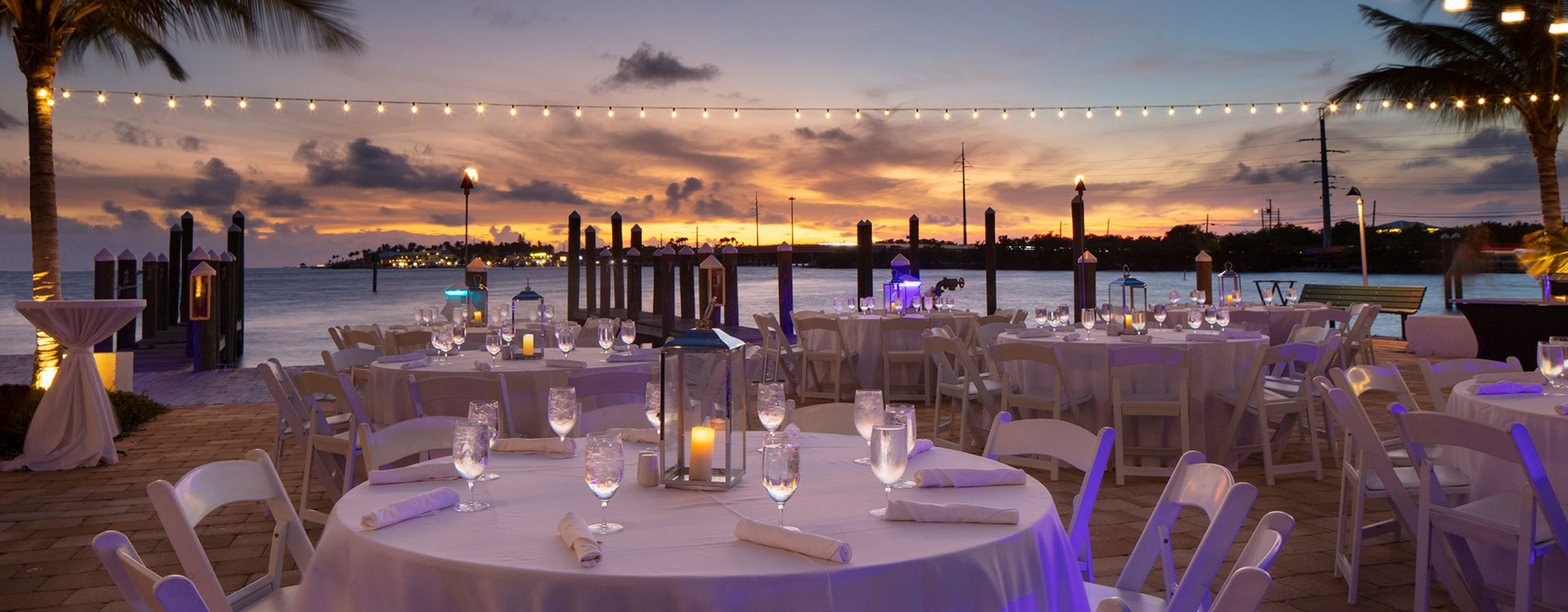 Event table set up by the water during sunset