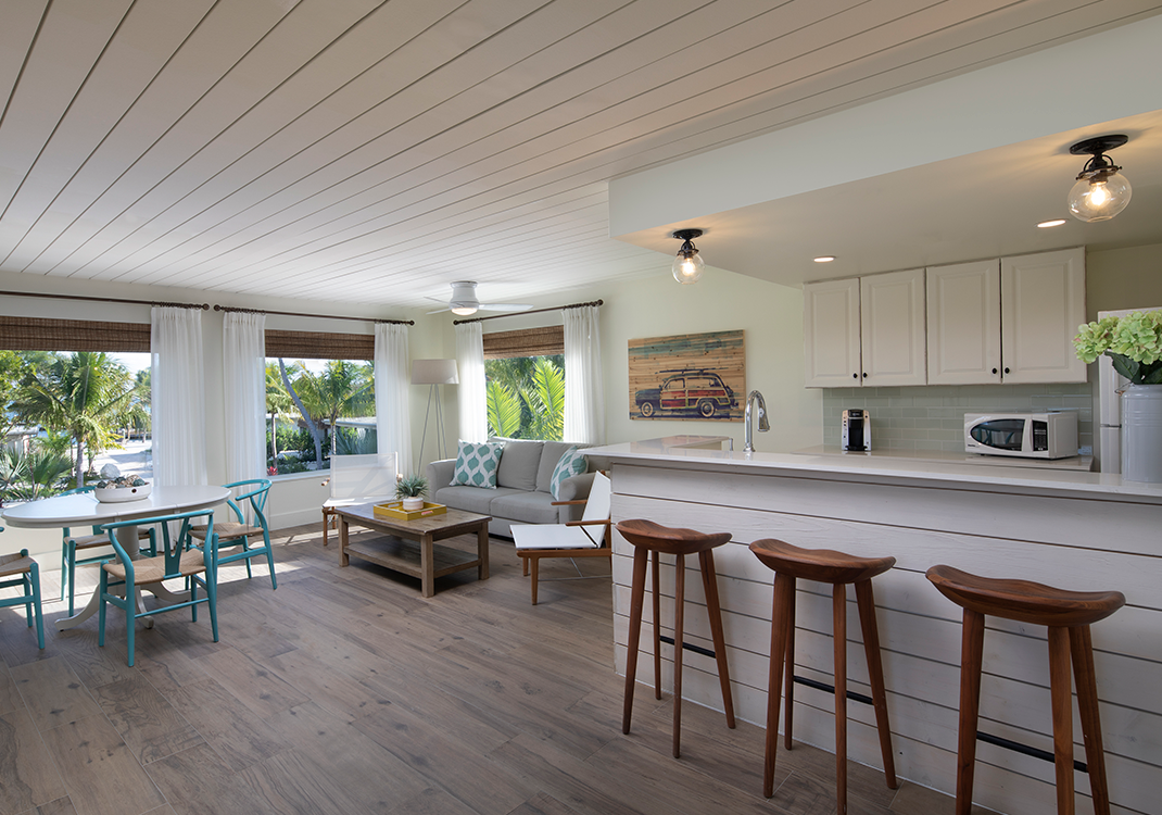 Cottage living room and kitchen at Postcard Inn in Islamorada